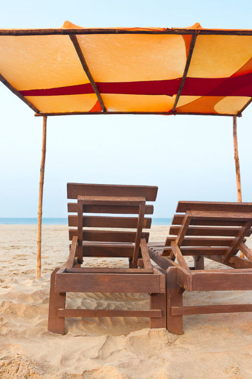 chairs on the beach in Goa, India